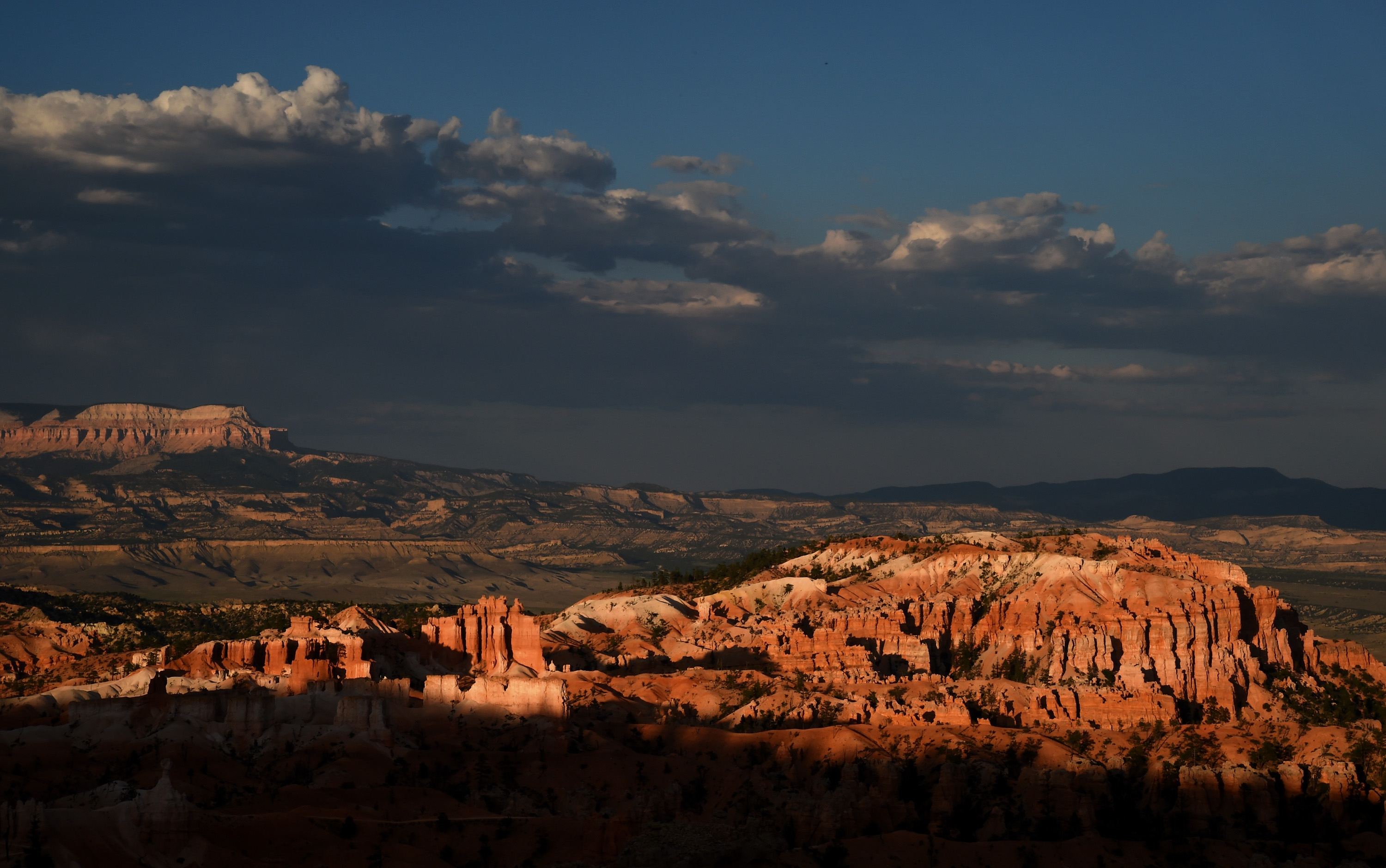 Bristlecone Point is illuminated by the setting sun above hoodoos viewed from Sunset Point overlooking Bryce Amphitheater on August 12, 2016 in Bryce Canyon National Park, Utah.  (Getty)