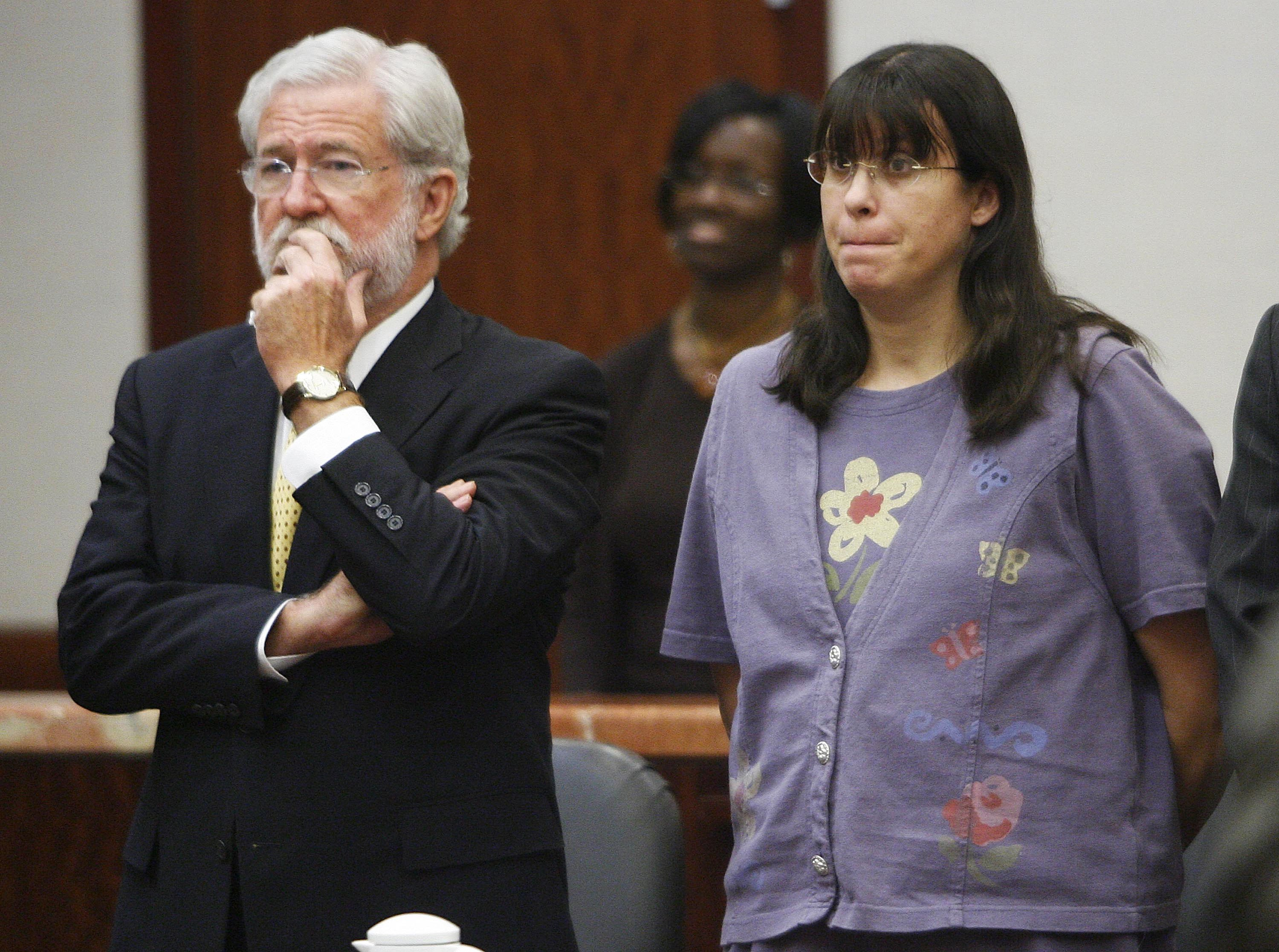 Andrea Yates stands with her attorney George Parnham. (Getty)