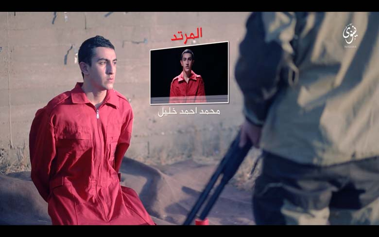 A screenshot from a purported ISIS video. One of the three men charged with spray painting anti-ISIS graffiti has a gun pointed at his head. A video of him and his charges are display next to his head.Find more ISIS news, photos and videos here.