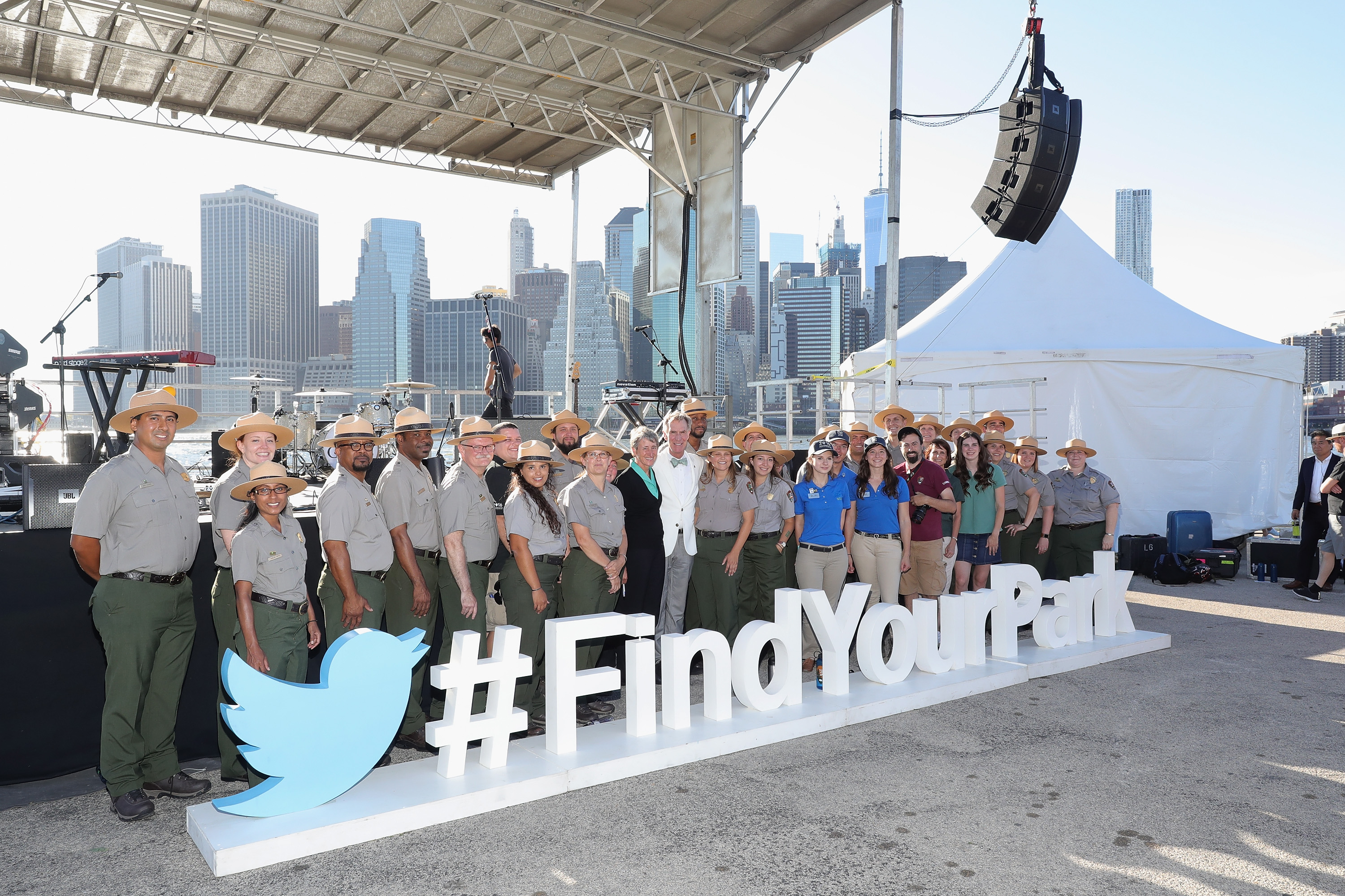 Secretary of the Interior Sally Jewell and Bill Nye join National Park Service Rangers and guests for a photo during the National Park Foundation's #FindYourPark event, celebrating the National Park Service's centennial at Brooklyn Bridge Park on August 22, 2016 in New York City.  (Getty)