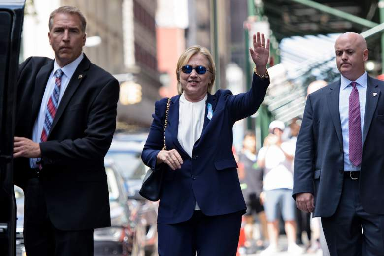 """US Democratic presidential nominee Hillary Clinton waves to the press as she leaves her daughter's apartment building after resting on September 11, 2016 in New York. Clinton departed from a remembrance ceremony on the 15th anniversary of the 9/11 attacks after feeling """"overheated,"""" but was later doing """"much better,"""" her campaign said. (Getty)"""