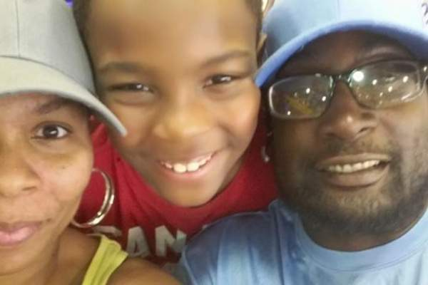 Keith Lamont Scott, right, is seen here with his son and wife. (Gofundme)
