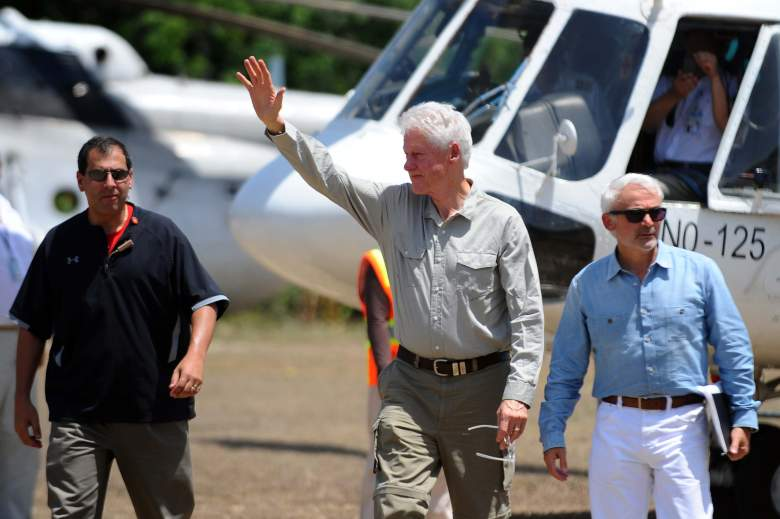 Former US President Bill Clinton arrives to visit a peanut plantation in Tierra Muscady, in the central plateau of Haiti, on June 29, 2014. The Clinton Giustra Enterprise Partnership, an initiative of the Clinton Foundation, founded by the former US president nd philanthropist Frank Giustra, today announced the launch of the Acceso Peanut Enterprise Corporation, a supply chain enterprise in Haiti that will improve the livelihoods of more than 12,000 smallholder peanut farmers. The Enterprise partnership will provide a network of service depots throughout the central plateau and northern regions of the country providing training to farmers as well as the collection and safe storage of peanuts. AFP PHOTO/Hector RETAMAL (Photo credit should read HECTOR RETAMAL/AFP/Getty Images)