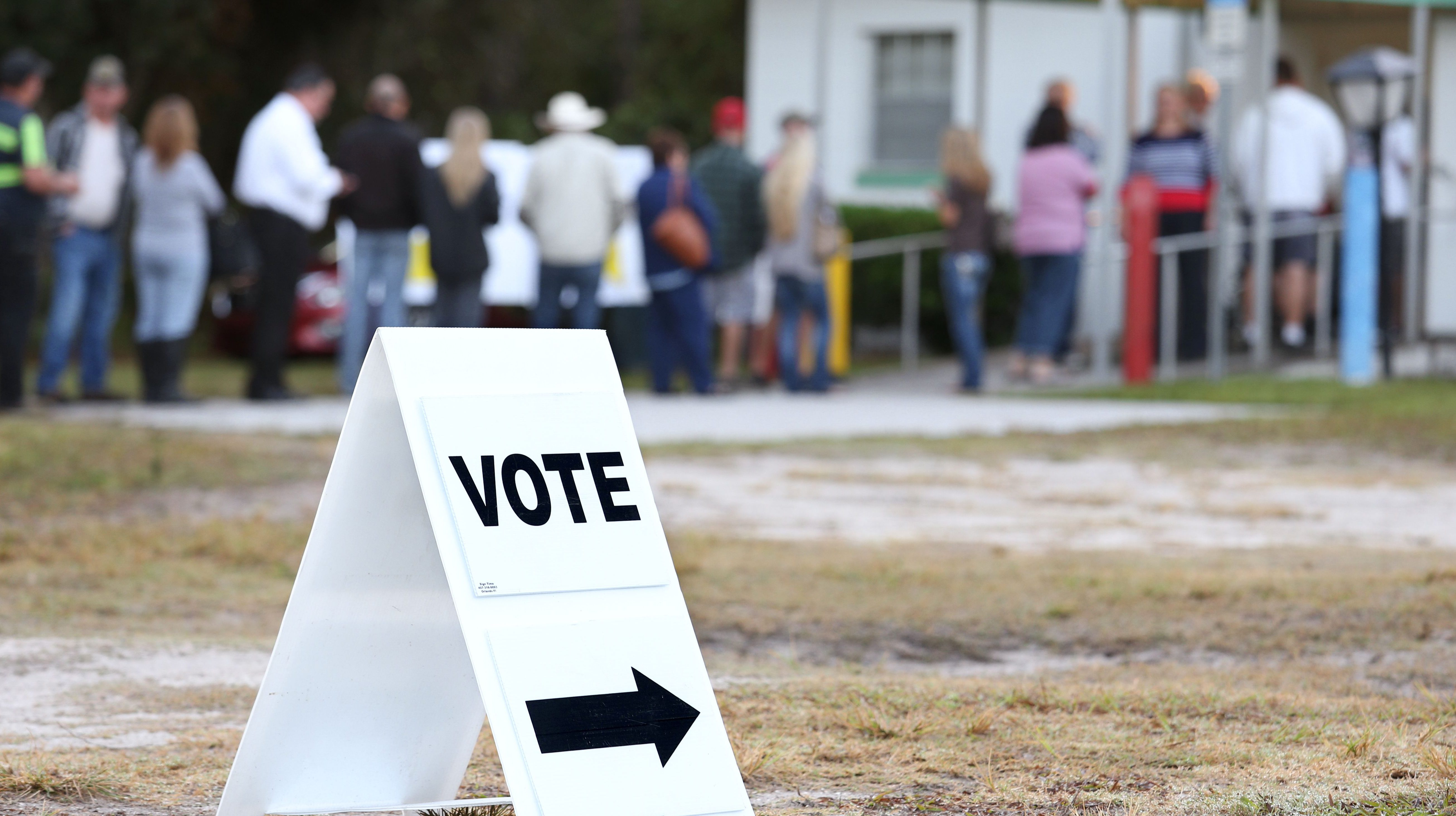 Voters wait in a queue to cast their ballots in the presidential election at a polling station in Christmas, Florida on November 8, 2016. (Getty)