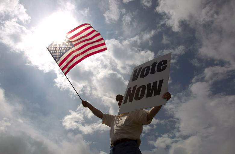 JayDanny Cooper urges Alabama residents to vote in the primary along the side of a highway March 13, 2012 in Birmingham, Alabama. (Getty)