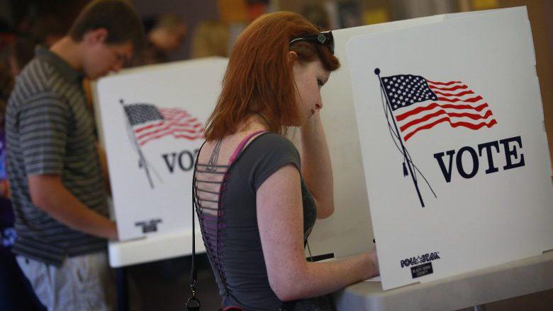 iowa early voting, iowa voting booth, iowa polling precinct