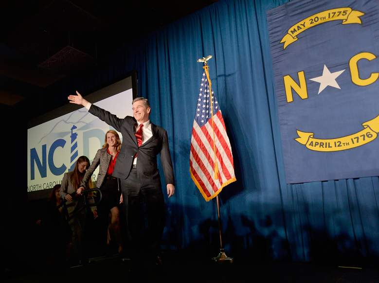 RALEIGH, N.C - NOVEMBER 9: North Carolina Democratic presumptive Governor elect Roy Cooper waves to a crowd at the North Carolina Democratic Watch Party as he walks on stage with his family on November 9, 2016 in Raleigh, North Carolina. North Carolina's gubernatorial race was still too close to call at 1:00 a.m. Cooper stated he felt positive the votes would fall in his favor. (Photo by Sara D. Davis/Getty Images)