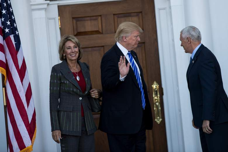BEDMINSTER TOWNSHIP, NJ - NOVEMBER 19: (L to R) Betsy DeVos, president-elect Donald Trump and vice president-elect Mike Pence prepare to head inside the clubhouse after posing for a photo at Trump International Golf Club, November 19, 2016 in Bedminster Township, New Jersey. Trump and his transition team are in the process of filling cabinet and other high level positions for the new administration. (Photo by Drew Angerer/Getty Images)