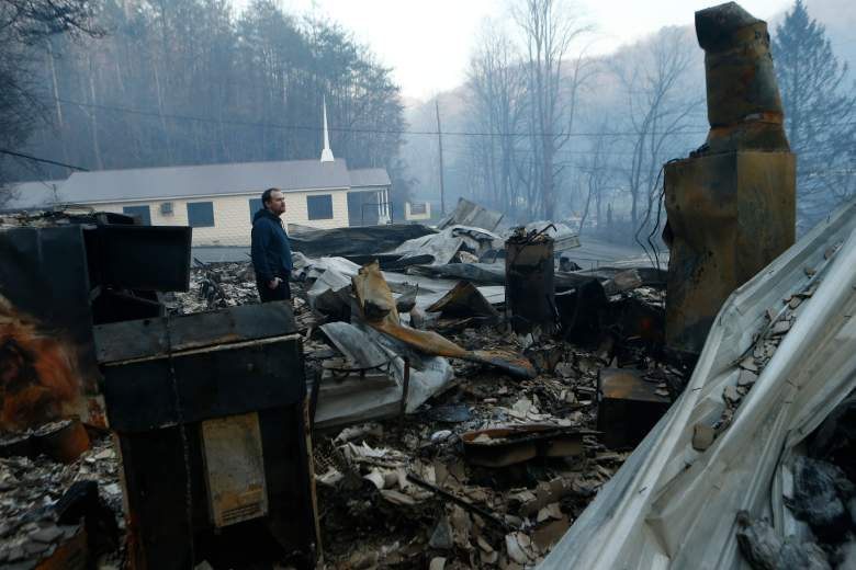 GATLINBURG, TN - NOVEMBER 29: Trevor Cates, walks through the smoldering remains of the fellowship hall of his church, the Banner Missionary Baptist Church as he inspects damage after a widfire November 29, 2016 in Gatlinburg, Tennessee. Thousands of people have been evacuated from the area and over 100 houses and businesses were damaged or destroyed. Drought conditions and high winds helped the fire spread through the foothills of the Great Smoky Mountains. (Photo by Brian Blanco/Getty Images)