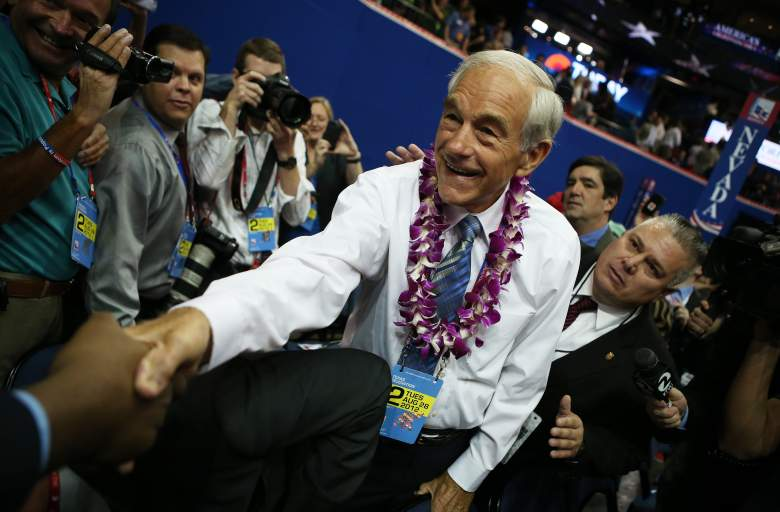 TAMPA, FL - AUGUST 28: U.S. Rep. Ron Paul (R-TX) (R) greets a supporter as he walks the arena floor during the second day of the Republican National Convention at the Tampa Bay Times Forum on August 28, 2012 in Tampa, Florida. Today is the first full session of the RNC after the start was delayed due to Tropical Storm Isaac. (Photo by Chip Somodevilla/Getty Images)