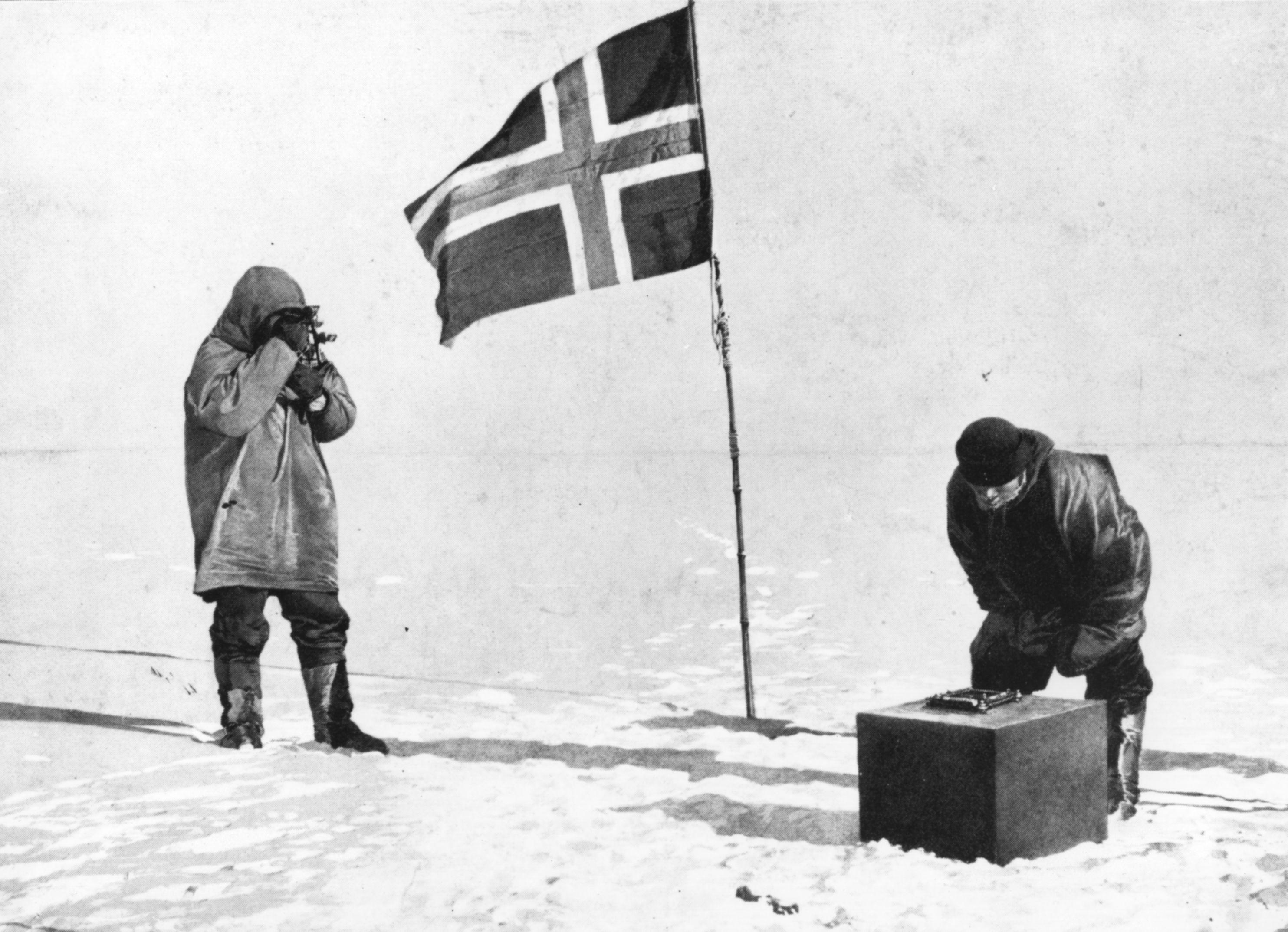 Norwegian explorer Captain Roald Amundsen taking sights at the South Pole, beside the Norwegian flag.   (Illustrated London News/Getty)
