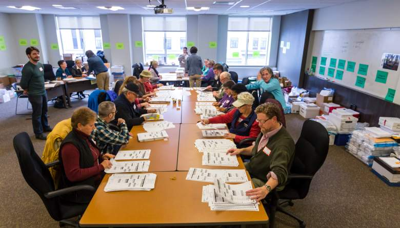 MADISON, WI - DECEMBER 01: Tabulators separate ballots into piles for each presidential candidate during a recount in Dane County (Wis.) on December 1, 2016 in Madison, Wisconsin. Green Party candidate Jill Stein has requested Wisconsin and other states to recount the U.S. presidential election. (Photo by Andy Manis/Getty Images)