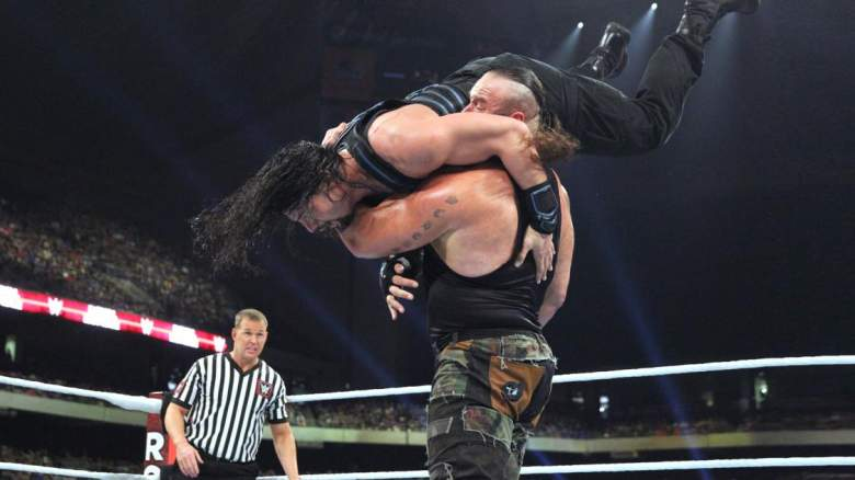 Braun Strowman interferes in a match between Roman Reigns and Kevin Owens. (WWE.com)