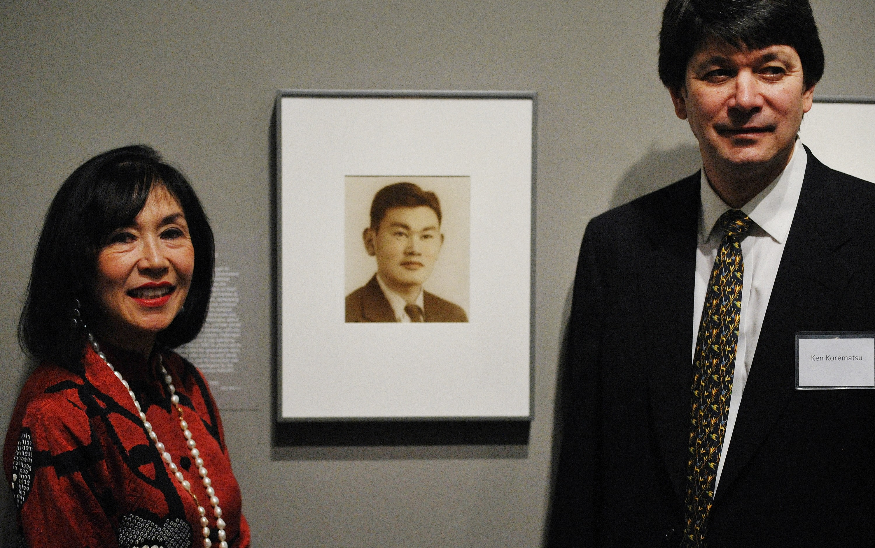 Karen and Ken Korematsu pose near photographs of their father Fred Korematsu during a presentation of his portrait to the National Portrait Gallery on February 2, 2012 in Washington, DC. (Getty)