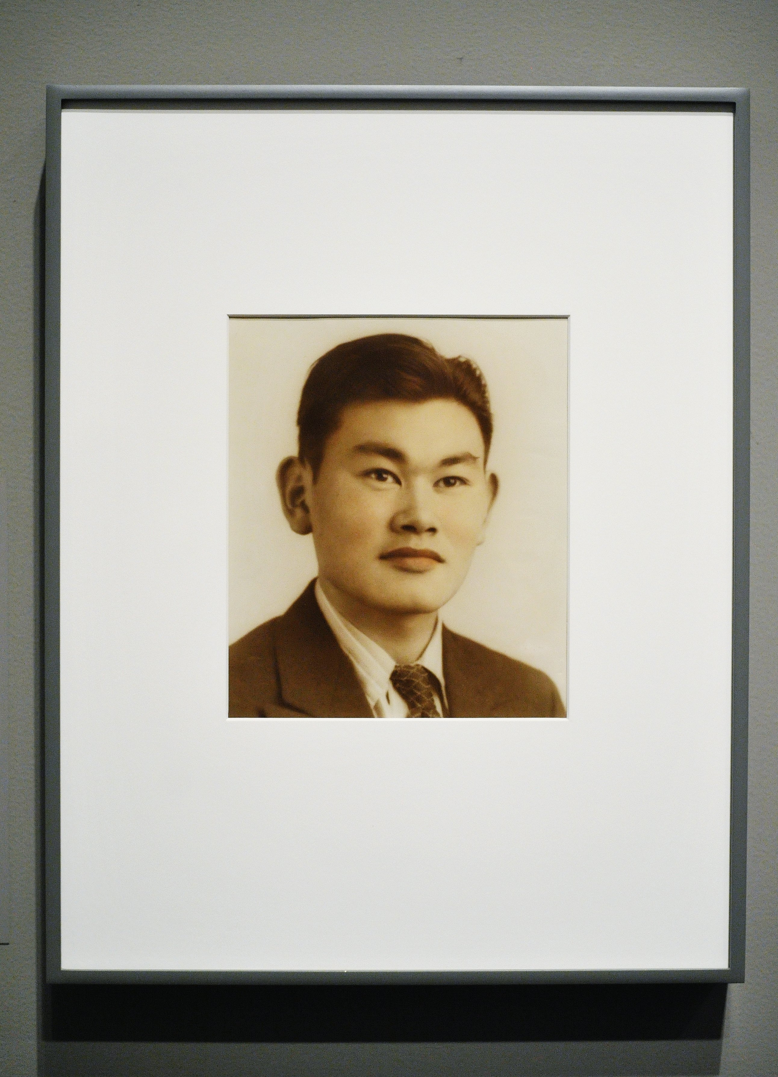 The portrait of Fred Korematsu is seen during its presentation to the National Portrait Gallery on February 2, 2012 in Washington, DC. The 1940s era photograph becomes part of the museum's permanent collection. (Getty)