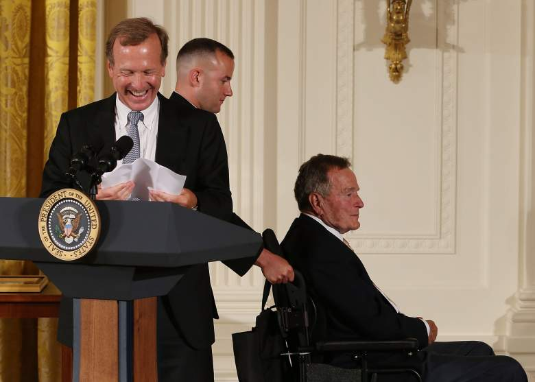 WASHINGTON, DC - JULY 15: Neil Bush (L) smiles as his father former President George H. W. Bush is pushed past during an event in the East Room during an event at the White House, July 15, 2013 in Washington, DC. Bush joined President Obama in hosting the event to honor the 5,000th Daily Point of Light Award winner. (Photo by Mark Wilson/Getty Images)