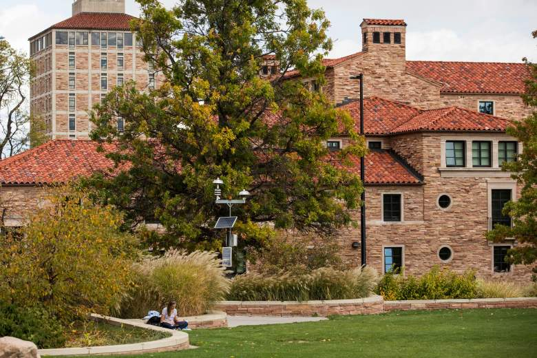 A girl sits on a lawn at the University of Colorado campus on October 27, 2015 in Boulder, Colorado. (Getty)