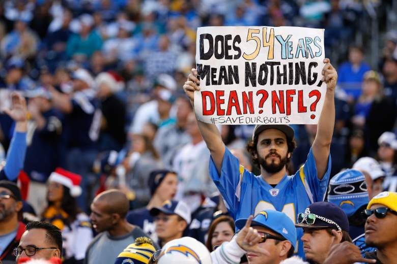 A fan holds a sign supporting the San Diego Chargers during a game  stands in the crowd. The franchise is expected to officially announce its move to Los Angeles on January 12. (Getty)