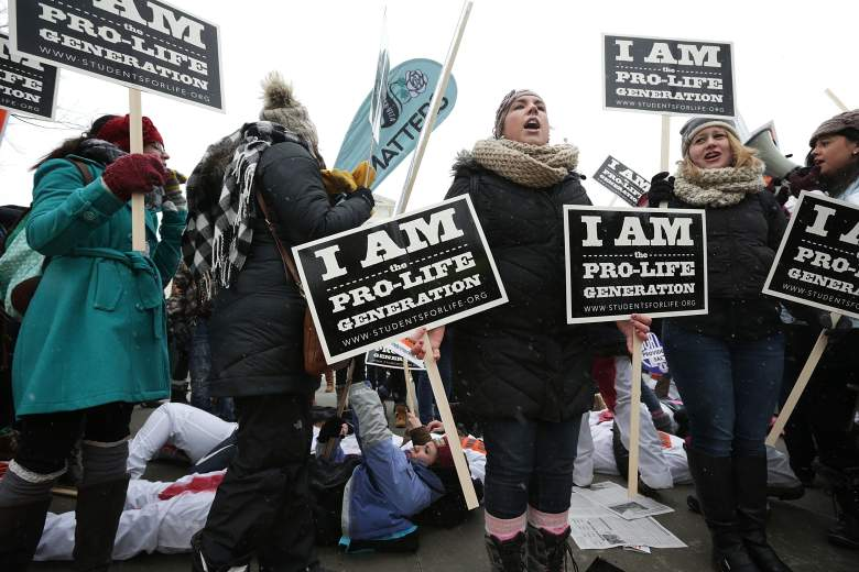 Pro-choice activists participate in a die-in during a 'Rise Up for Roe' rally outside the U.S. Supreme Court as pro-life activists intervene during the 2016 March for Life event January 22, 2016 in Washington, DC. The annual March for Life event marked the anniversary of the Supreme Court Roe v. Wade ruling in 1973. (Photo by Alex Wong/Getty Images)