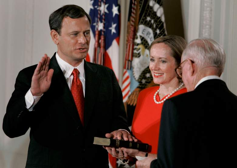 Jane Roberts holds a Bible as John Roberts is sworn in as Chief Justice of the United States Supreme Court by Associate Justice John Paul Steven. (Getty)