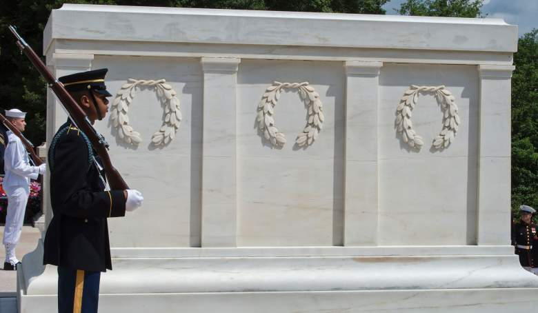 Members of the US Military Honor Guard stand in position shortly before Singapore Prime Minister Lee Hsien Loong places a wreath at the Tomb of the Unknown Soldier August 1, 2016 at Arlington National Cemetery in Arlington, Virginia. / AFP / Paul J. Richards (Photo credit should read PAUL J. RICHARDS/AFP/Getty Images)