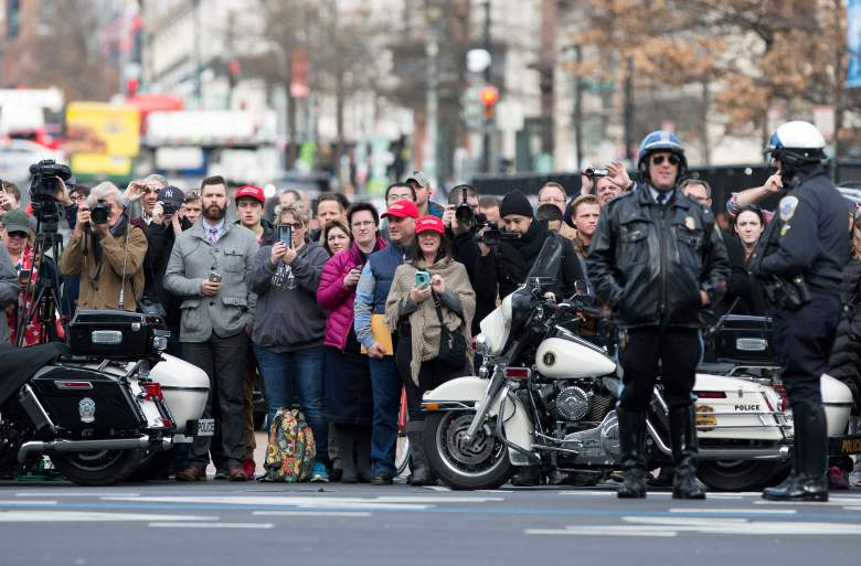 WASHINGTON, DC - JANUARY 19: (AFP OUT) Onlookers await a sighting of President-elect of The United States Donald J. Trump outside Trump International Hotel the day before his swearing in January 19, 2017 in Washington, DC. Hundreds of thousands of people are expected to come to the National Mall to witness Trump being sworn in as the 45th president of the United States. (Photo by Chris Kleponis-Pool/Getty Images)
