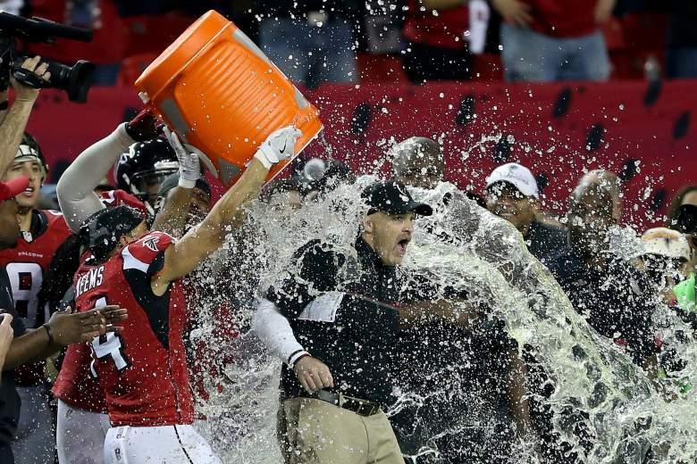 Falcons head coach Dan Quinn gets gatorade dumped on him by his team. (Getty)