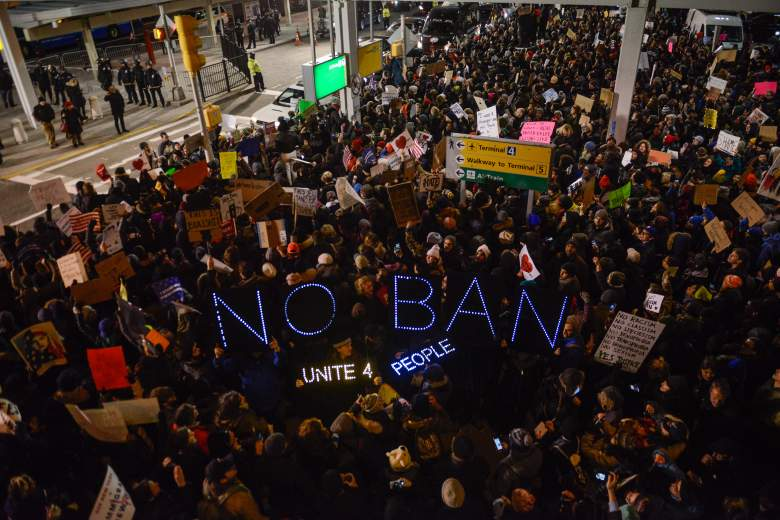 Protestors rally  during a demonstration against the Muslim immigration ban at JFK airport January 28 in New York City. (Getty)