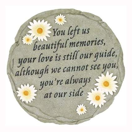 memorial stepping stone with words and flowers