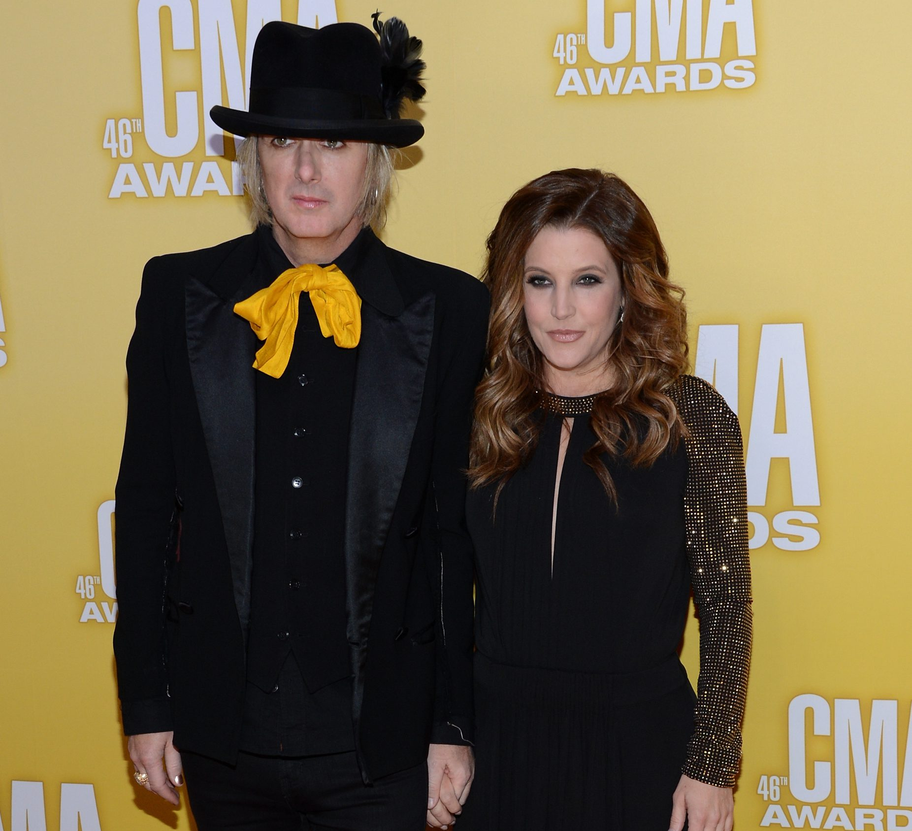 NASHVILLE, TN - NOVEMBER 01:  Lisa Marie Presley (R) and Michael Lockwood attend the 46th annual CMA Awards at the Bridgestone Arena on November 1, 2012 in Nashville, Tennessee.  (Photo by Jason Kempin/Getty Images)