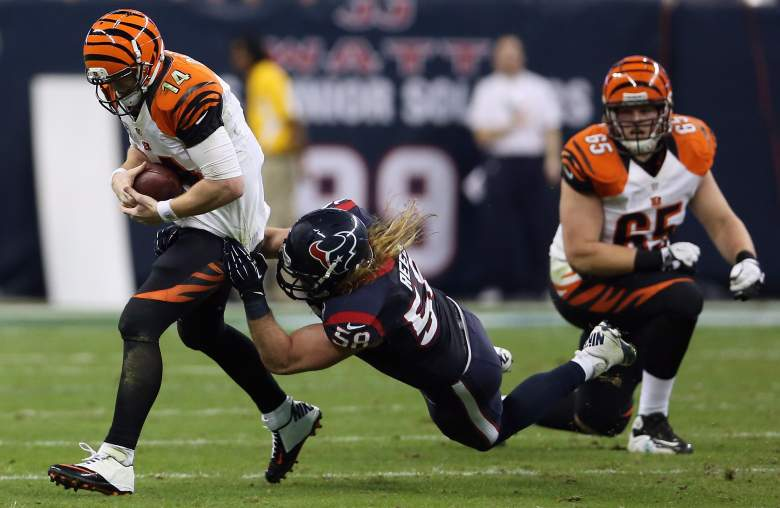 Andy Dalton of the Cincinnati Bengals is tackled by Brooks Reed of the Houston Texans during the AFC Wild Card Playoff Game at Reliant Stadium on January 5, 2013 in Houston, Texas. (Getty Images)