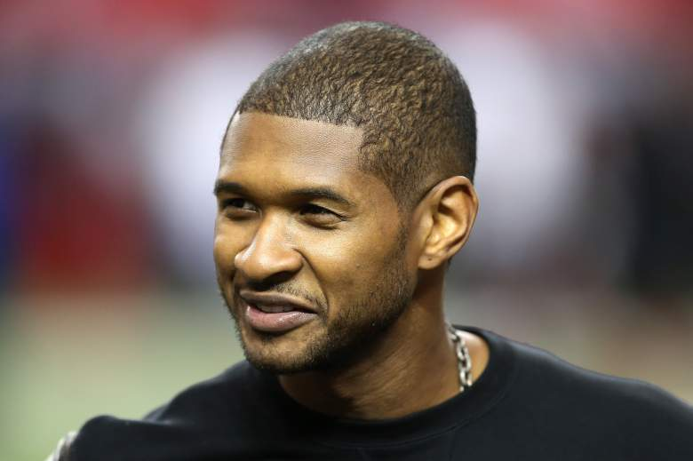 Usher stands on the field during warm ups prior to an Atlanta Falcons game in 2013. (Getty)