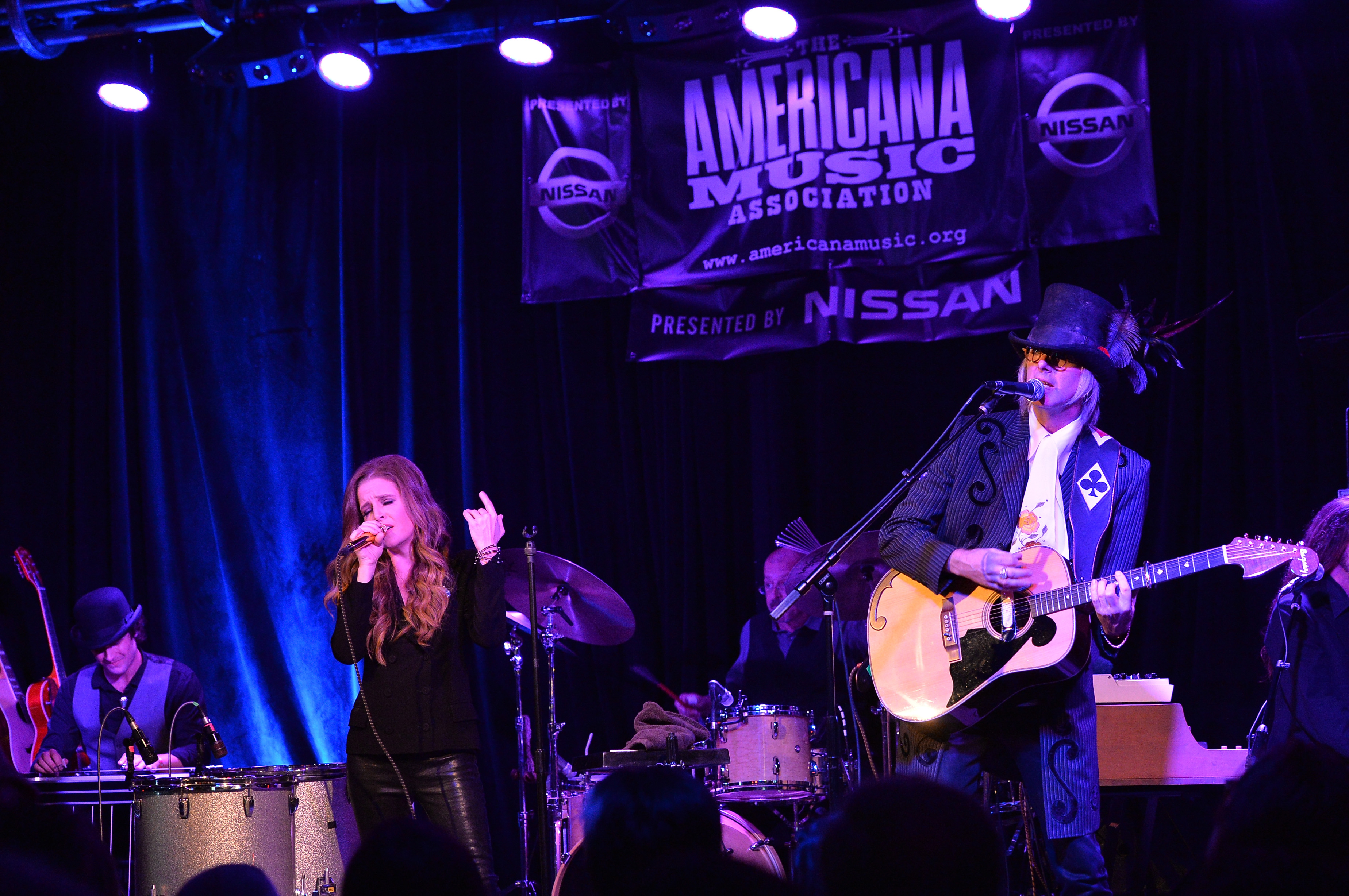 Lisa Marie Presley and Husband Michael Lockwood perform at 3rd &  Lindsley during the 14th Annual Americana Music Festival & Conference - Festival - Day 3 on September 20, 2013 in Nashville, United States.  (Getty)