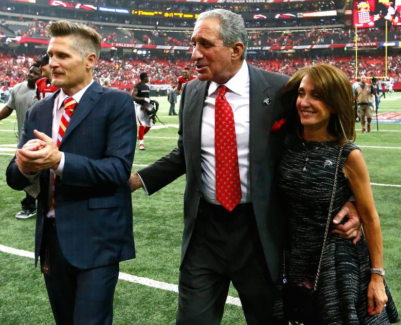Atlanta Falcons general manager Thomas Dimitroff, team owner Arthur Blank, and Angela Macuga celebrate their 37-34 overtime win over the New Orleans Saints at Georgia Dome in 2014. (Getty)