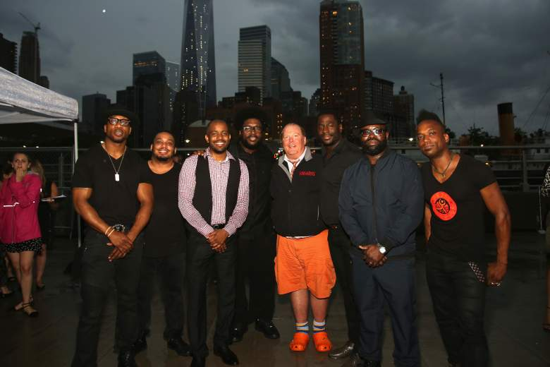 Chef Mario Batali poses with The Roots at the Infiniti presents The (RED) Supper to launch EAT (RED) DRINK (RED) SAVE LIVES on May 31, 2015. (Getty)