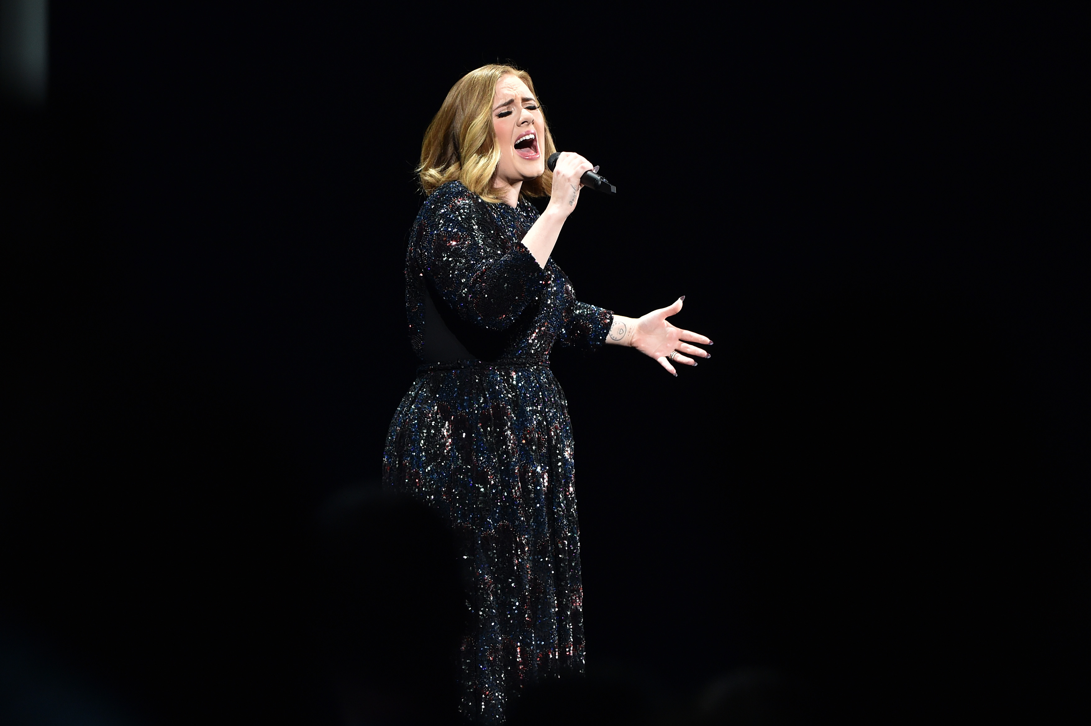 Adele performs at Genting Arena on March 29, 2016 in Birmingham, England. (Photo by Gareth Cattermole/Getty)