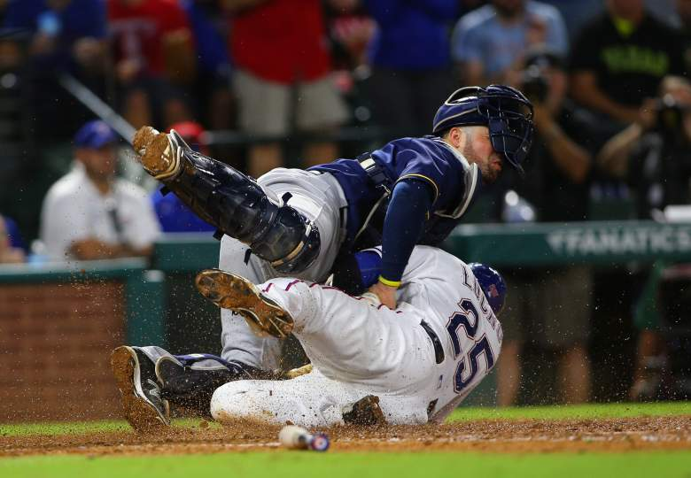 Jonathan Lucroy of the Texas Rangers collides with Manny Pina of the Milwaukee Brewers before being called out during a game in 2016. (Getty)