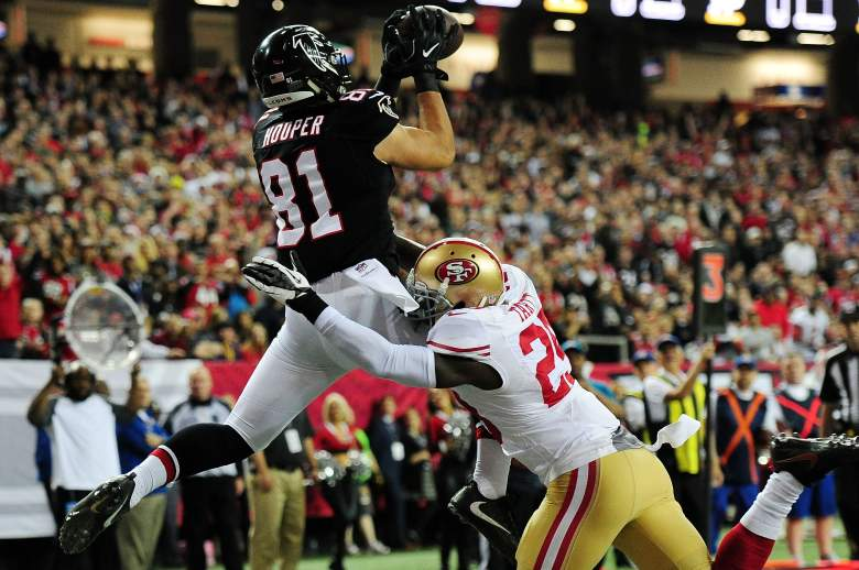Austin Hooper of the Atlanta Falcons scores a touchdown over Jaquiski Tartt #29 of the San Francisco 49ers during the first half at the Georgia Dome on December 18, 2016. (Getty)