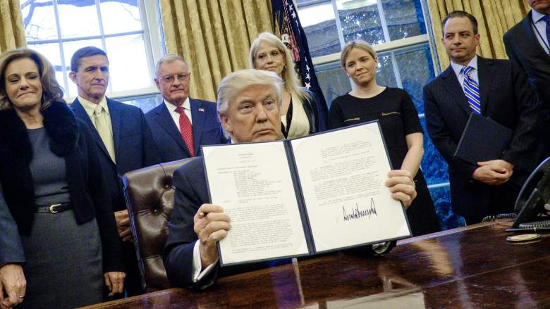 President Donald Trump holds up one of the executive actions that he signed on January 28. The orders have since been made into a meme that is making its way around the internet.  (Getty)