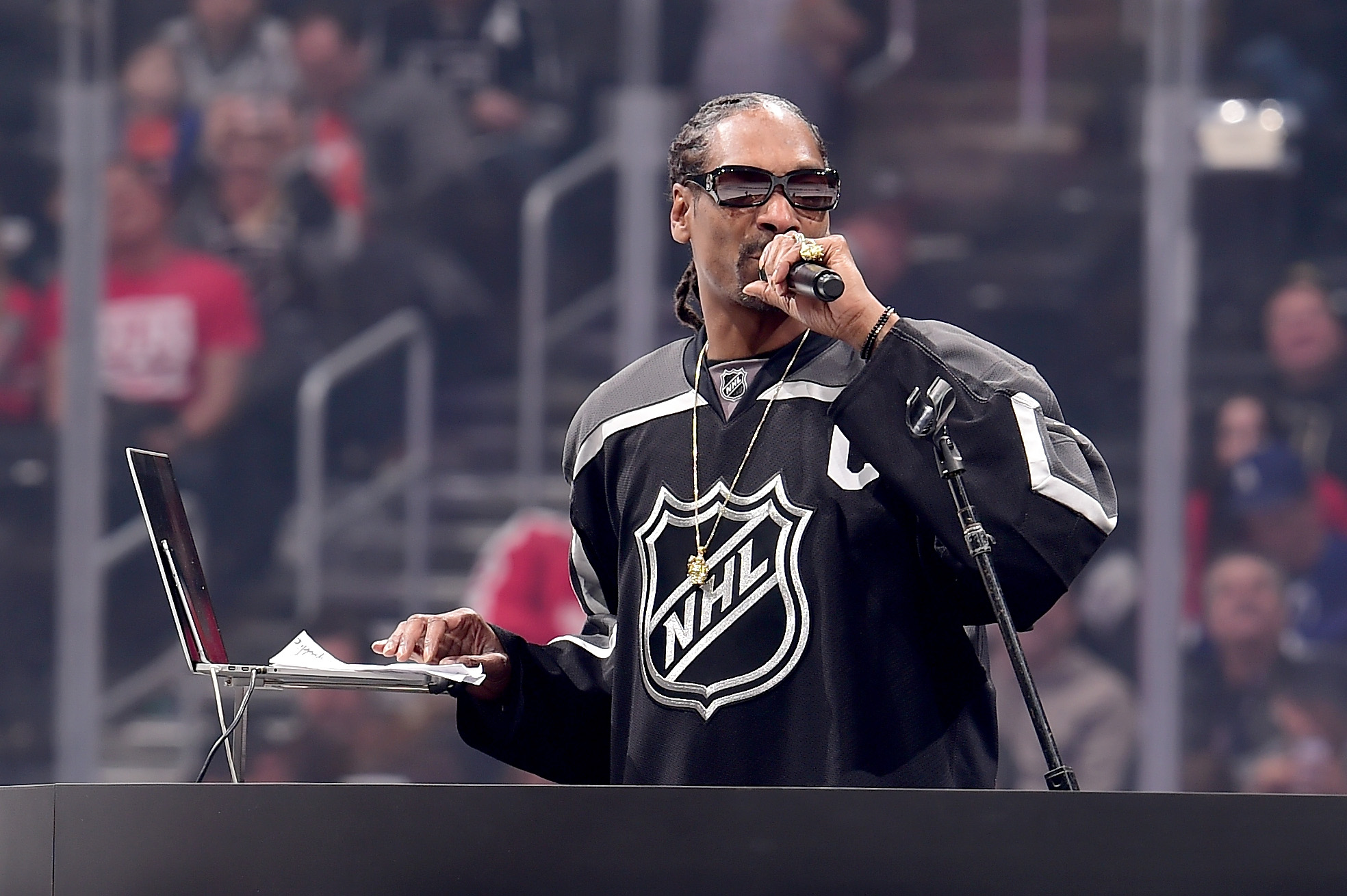 Snoop Dogg shows his hosting skills at the NHL All-Star Skills Competition on January 28, 2017 in Los Angeles, California.  (Photo by Harry How/Getty Images)