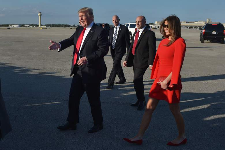 US President Donald Trump and wife Melania make their way across the tarmac to greet well-wishers upon arrival at Palm Beach International Airport in West Palm Beach, Florida on February 3, 2017. / AFP / Mandel Ngan        (Photo credit should read MANDEL NGAN/AFP/Getty Images)