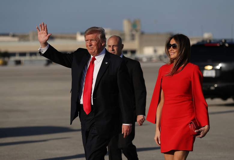 PALM BEACH, FL - FEBRUARY 03:  U.S. President Donald Trump  walks with his wife Melania Trump on the tarmac after he arrived on Air Force One at the Palm Beach International Airport for a visit to his Mar-a-Lago Resort for the weekend on February 3, 2017 in Palm Beach, Florida. President Donald Trump is on his his first visit to Palm Beach since his inauguration.  (Photo by Joe Raedle/Getty Images)