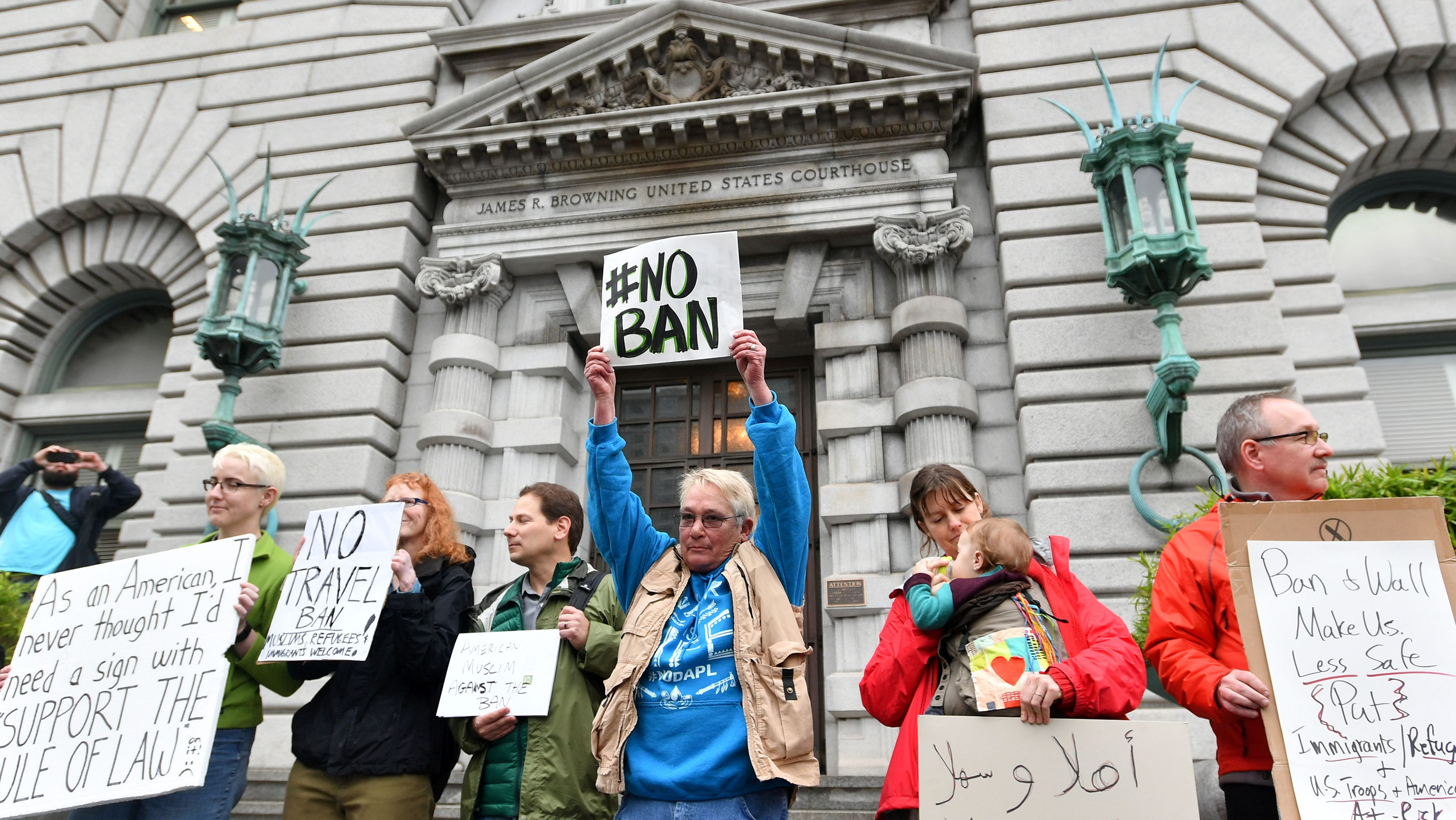 Protesters stand in front of the United States Court of Appeals for the Ninth Circuit in San Francisco, California on February 7, 2017. (Getty)