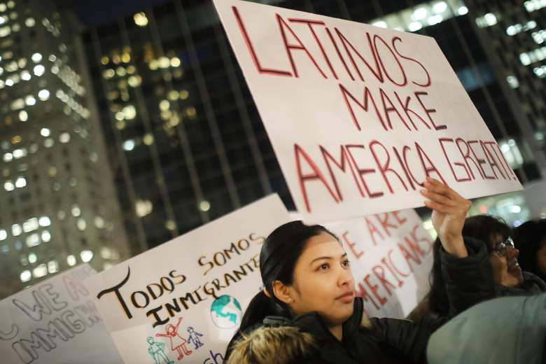 """NEW YORK, NY - FEBRUARY 14: People, many of whom are undocumented, attend a Valentines Day rally organized by the New York Immigration Coalition called """"Love Fights Back"""" on February 14, 2017 in New York City. A series of U.S. Immigration and Customs Enforcement (ICE) raids throughout the New York City area last week has sent fears of deportations throughout New York's heavily immigrant communities. According to a 2013 study by the City Planning Commission, nearly 40% of the city's population of 8.2 million is foreign-born. During his campaign President Donald Trump stated that he would deport those with a criminal conviction and in America illegally. (Photo by Spencer Platt/Getty Images)"""
