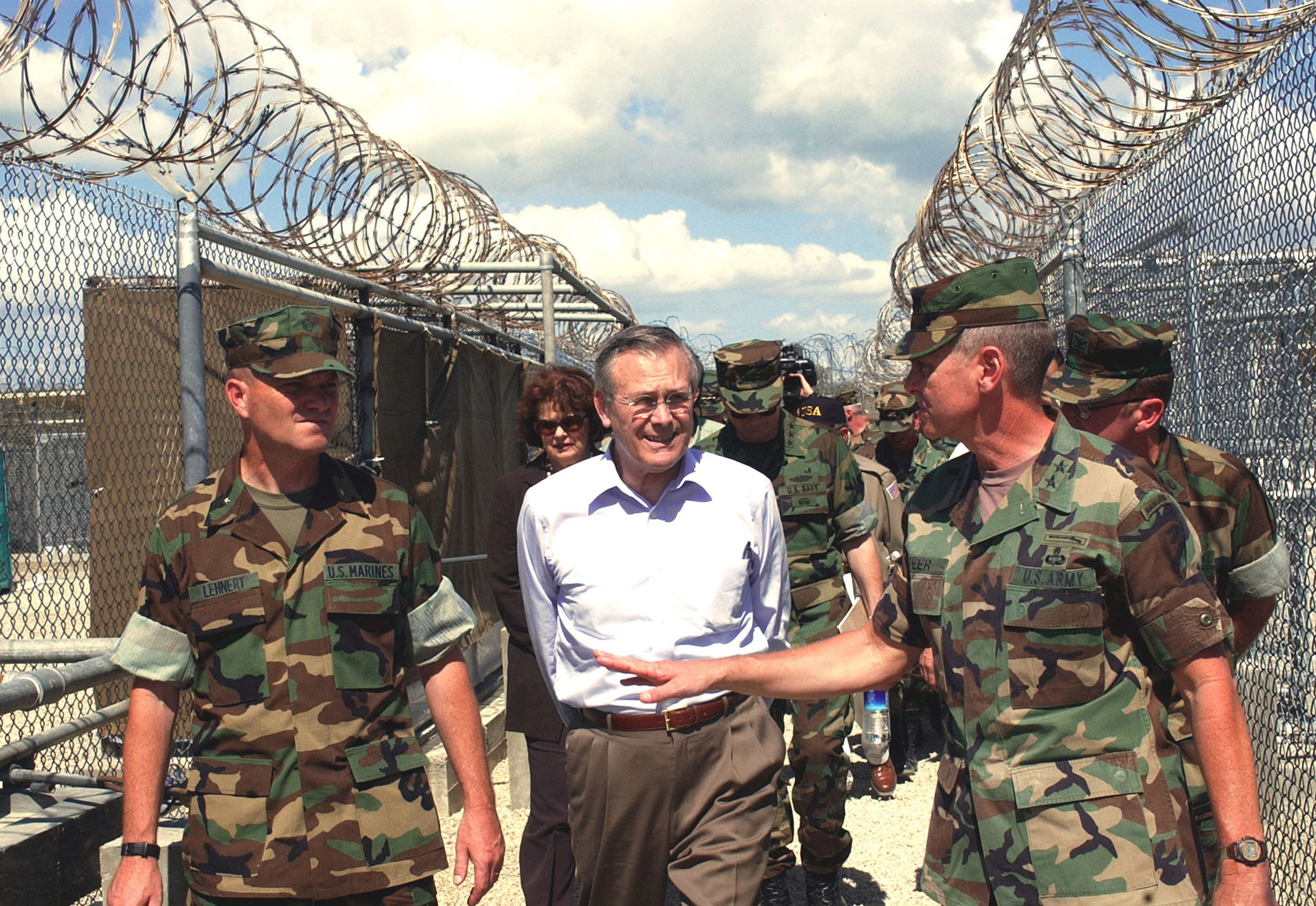 Then-Secretary of Defense Donald Rumsfield tours Guantanamo. (Getty)