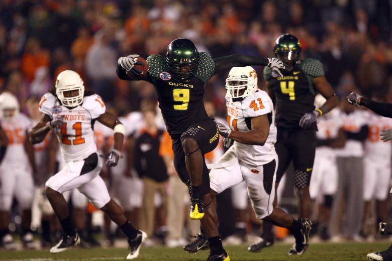 LeGarrette Blount of the University of Oregon Ducks hurdles a player en route to a touchdown on December 30, 2008. (Getty)