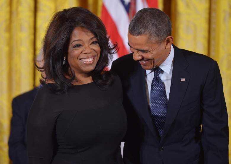Barack Obama chats with Oprah Winfrey before presenting her with the Presidential Medal of Freedom during a ceremony in the East Room of the White House on November 20, 2013. (Getty)