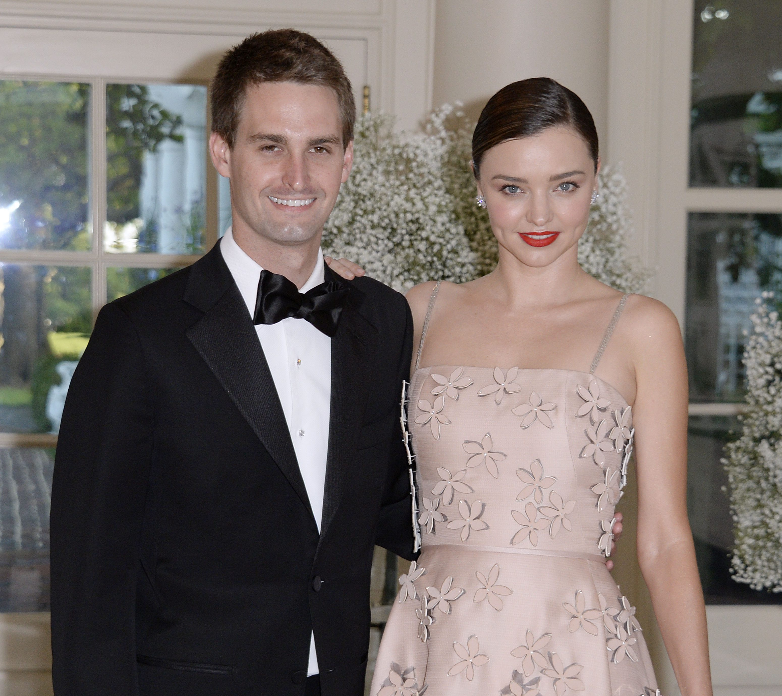 Miranda Kerr and her Snapchat CEO boyfriend, Evan Spiegel arrive at the state dinner in honor of President of Finland and the Prime Ministers of Norway, Sweden, Denmark and Iceland at the White House in Washington on May 13, 2016. (Getty)
