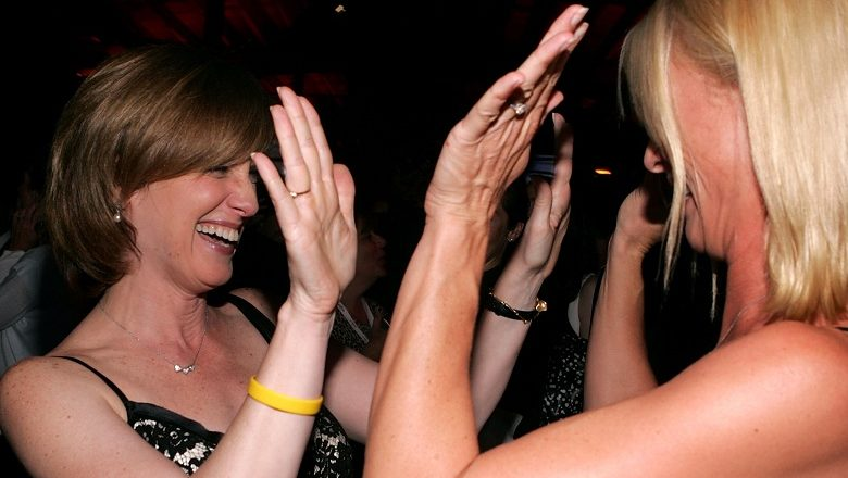 Two happy ladies, high-fiving each other