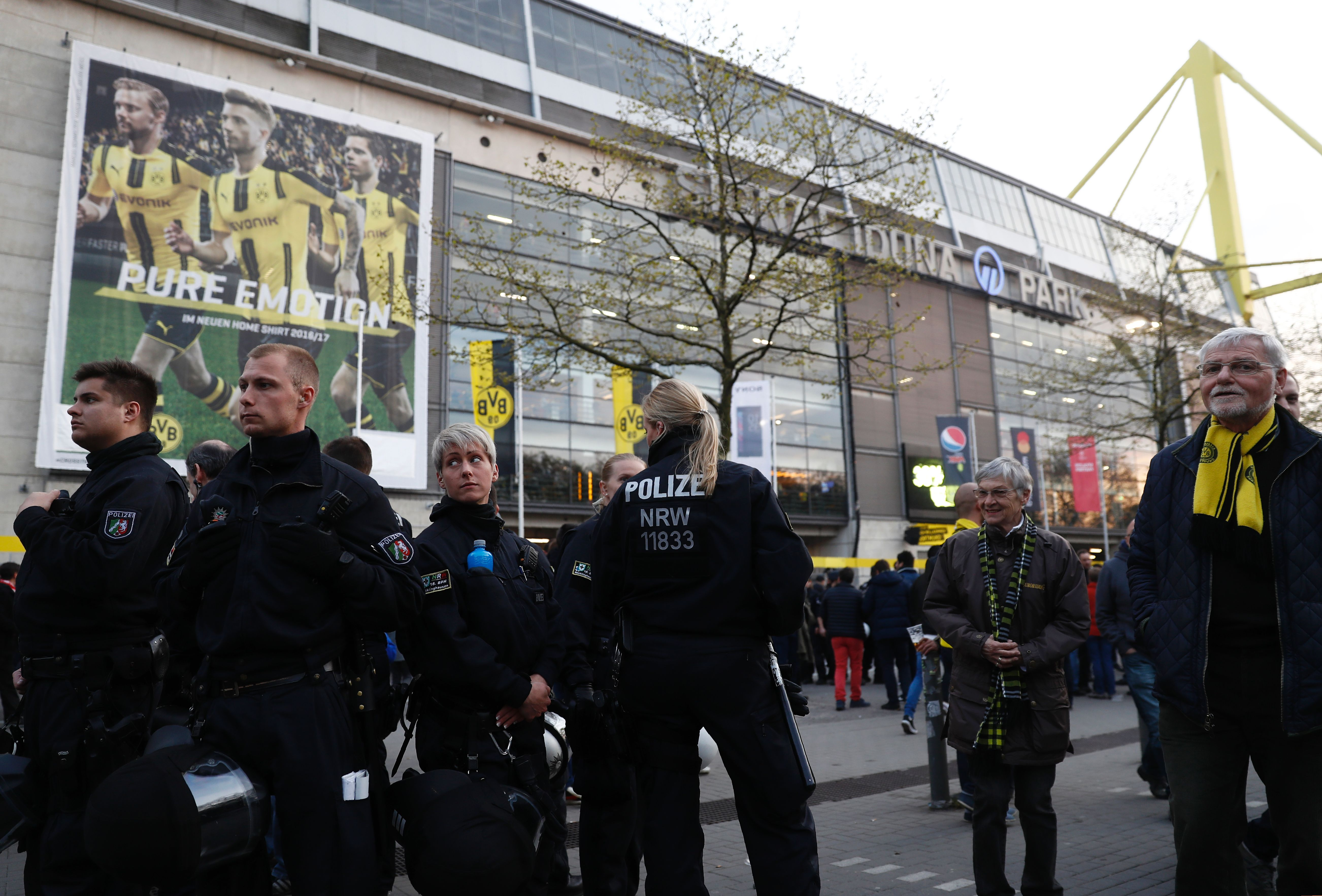 Ambulances are pictured inside stadium after the team bus of Borussia Dortmund had some windows broken by an explosion some 10km away from the stadium prior tothe UEFA Champions League 1st leg quarter-final football match BVB Borussia Dortmund v Monaco in Dortmund, western Germany on April 11, 2017. / AFP PHOTO / Odd ANDERSEN        (Photo credit should read ODD ANDERSEN/AFP/Getty Images)